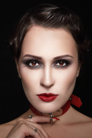 beautiful bdsm: Portrait of young beautiful woman in red collar