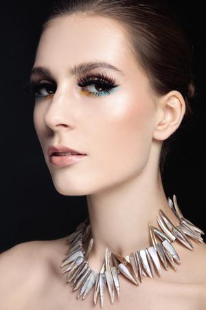 false eyelashes: Portrait of young beautiful slim woman with stylish make-up and false eyelashes