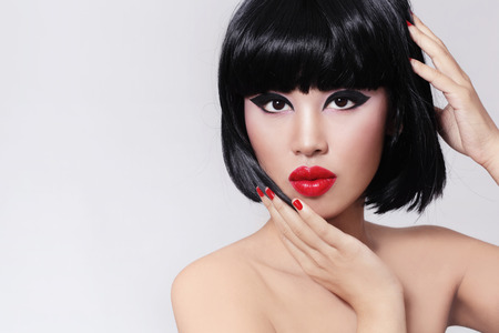 fillers: Young beautiful asian girl with stylish bob haircut and red lipstick