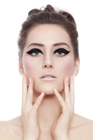 female eyes: Young beautiful woman with fancy cat eye make-up and stylish hairdo over white background