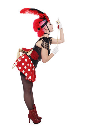 Pretty bourlesque girl in fancy costume with plumage over white background, copy space photo