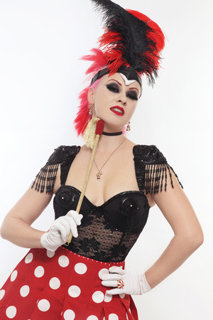 Pretty bourlesque girl in fancy costume with plumage photo