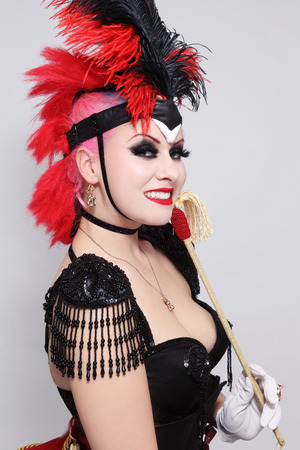 Pretty happy smiling bourlesque girl in fancy costume with plumage photo