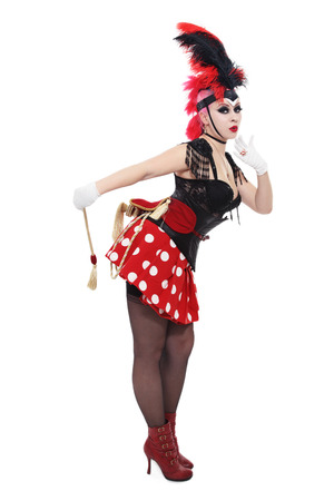 Pretty bourlesque girl in fancy costume with plumage over white background photo