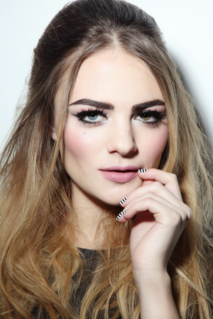 eye makeup: Young beautiful woman with winged eye make-up and stylish hairdo Stock Photo