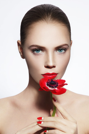nailpolish: Portrait of young beautiful woman with red flower and fancy manicure Stock Photo