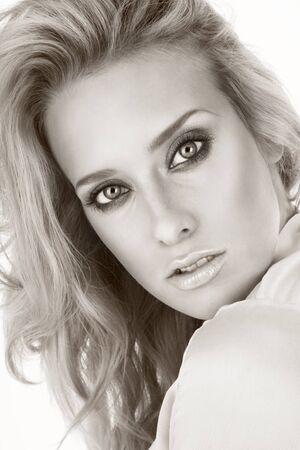 cheekbones: Duotone portrait of young beautiful blond woman with stylish make-up