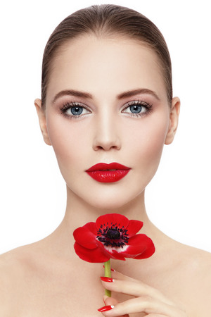 nailpolish: Portrait of young beautiful woman with red flower over white background Stock Photo