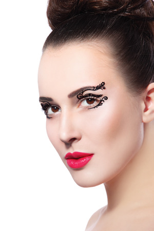 Portrait of young beautiful woman with fancy paper eye stickers and red lipstick over white background, copy space