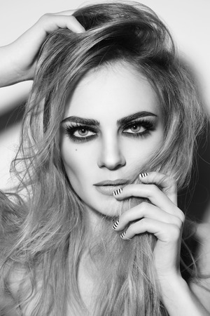 smoky eyes: Black and white shot of young beautiful sexy girl with smoky eyes and stylish striped manicure