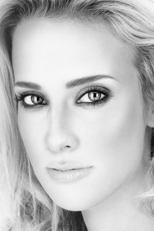 ageing: Black and white close-up portrait of young beautiful woman with smoky eyes