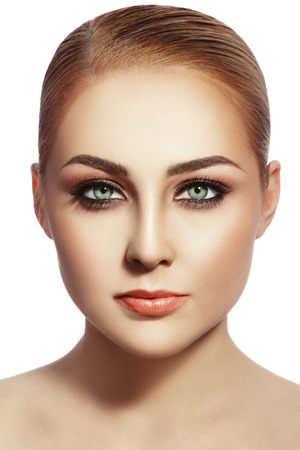 cheekbones: Portrait of young beautiful healthy woman with stylish make-up over white background