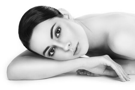 Black and white shot of young beautiful healthy woman with clean make-up
