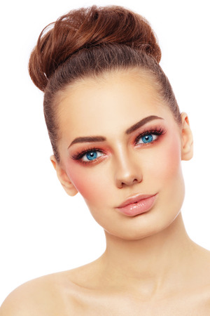 Portrait of young beautiful blue-eyed woman with stylish sunny make-up over white background Stock Photo