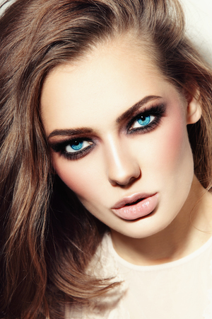 Portrait of young beautiful blue-eyed woman with smoky eyes Stock Photo