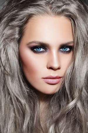 Close-up portrait of young beautiful woman with long grey hair and stylish smoky eyes make-up Stock Photo