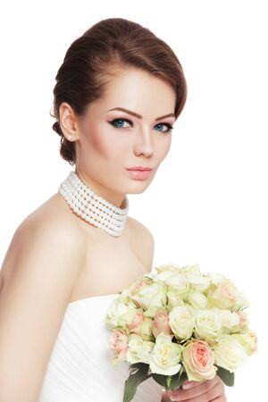 white wedding: Young beautiful happy bride with stylish make-up and bouquet over white background, copy space Stock Photo