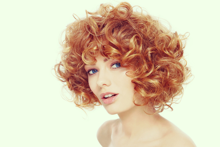 perming: Vintage style portrait of young beautiful happy healthy woman with curly red hair