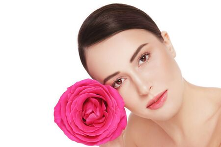 hot pink: Young beautiful healthy woman with hot pink rose over white background, copy space Stock Photo