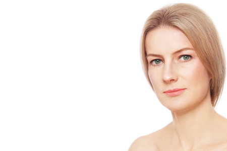 skin care woman: Portrait of beautiful healthy happy mature woman with clean make-up over white background, copy space