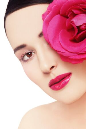 hot pink: Close-up portrait of young beautiful healthy woman with hot pink rose over white background, copy space