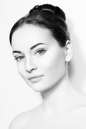 Black and white portrait of young beautiful woman with healthy skin