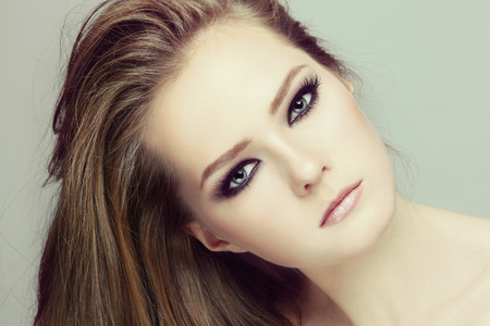 smoky eyes: Vintage style close-up portrait of young beautiful teen girl with smoky eyes make-up