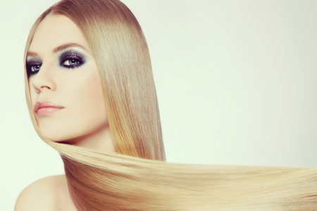 Young beautiful woman with long blond hair and fancy disco make-up