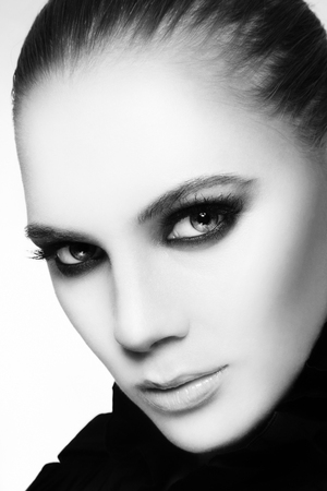 smoky eyes: Close-up black and white portrait of beautiful stylish young woman with smoky eyes