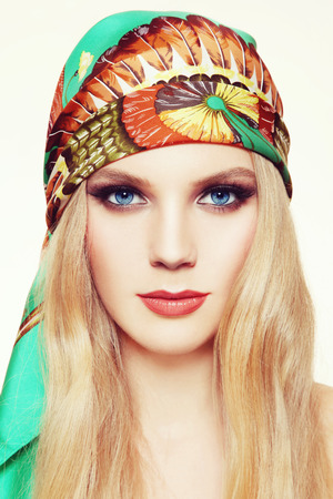 smoky eyes: Portrait of young beautiful woman with long hair and stylish smoky eyes make-up in green silk scarf Stock Photo