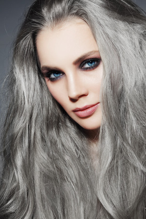 smoky eyes: Portrait of young beautiful woman with long grey hair and stylish smoky eyes make-up