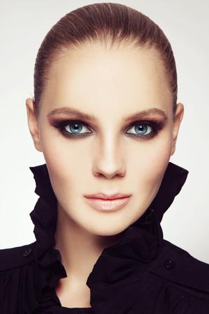 smoky eyes: Portrait of young beautiful woman with stylish sexy smoky eyes make-up Stock Photo