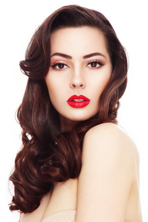 Portrait of young beautiful woman with long curly hair and red lipstick over white background