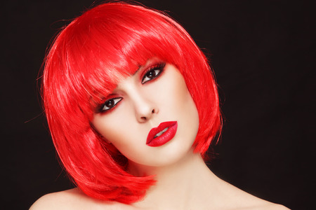 bob: Portrait of young beautiful sexy girl with stylish make-up and fancy bob style red wig Stock Photo
