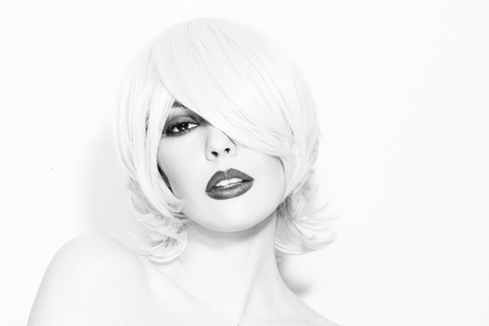 choppy: Black and white portrait of young beautiful woman with choppy lob with fringe and smoky eyes Stock Photo