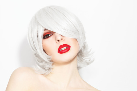 choppy: Portrait of young beautiful woman with choppy lob with fringe and stylish make-up