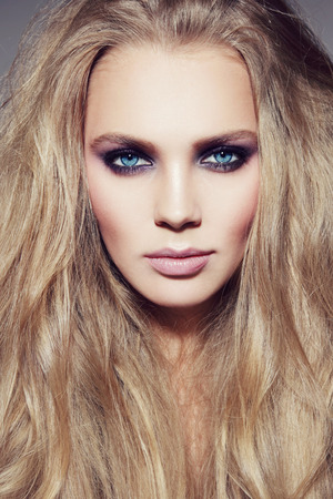 smoky eyes: Portrait of young beautiful woman with long hair and smoky eyes make-up Stock Photo