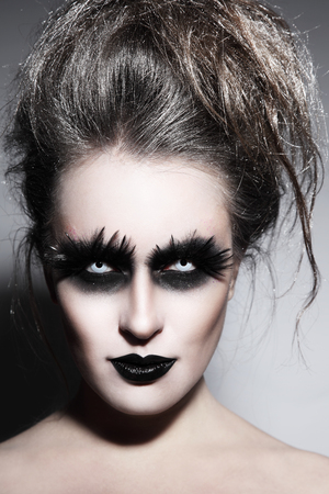 Woman with stylish fancy gothic Halloween make-up and hairdo Stock Photo