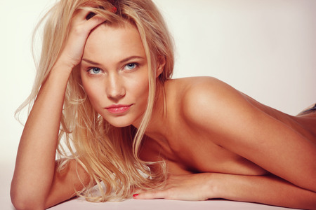 tanned: Vintage style portrait of young beautiful sexy blonde tanned woman
