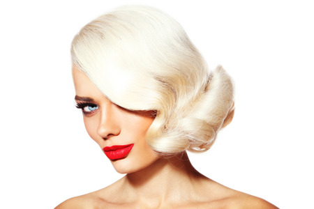 platinum hair: Portrait of young beautiful platinum blonde tanned woman with vintage hairdo and red lipstick over white background