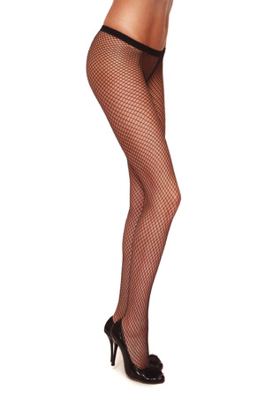 sexy legs stockings: Long slim legs of sexy tanned woman in fishnet stockings over white background