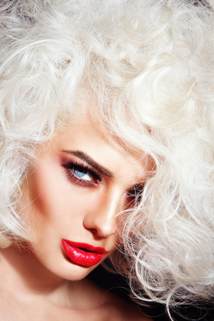 platinum hair: Close-up portrait of young beautiful woman with platinum blonde curly hair and red lipstick