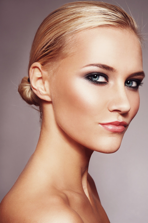 smoky eyes: Vintage style portrait of young beautiful blonde woman with smoky eyes Stock Photo