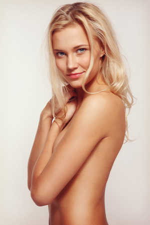 Vintage style portrait of young beautiful sexy blonde tanned woman photo