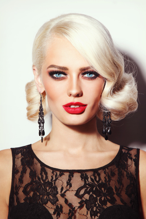 permanent wave: Portrait of young beautiful sexy platinum blonde woman with stylish hairdo and red lipstick Stock Photo