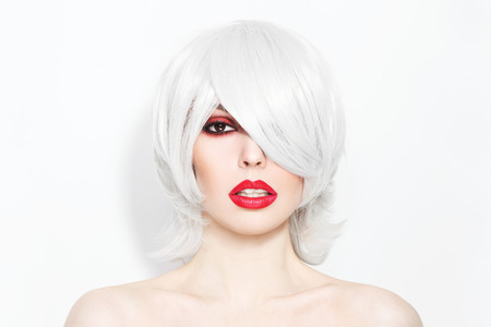 platinum hair: Portrait of young beautiful woman with choppy lob with fringe and stylish make-up