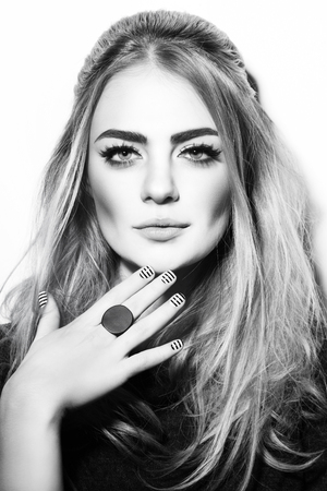 sixties: Black and white portrait of young beautiful sexy girl with stylish make-up and striped manicure