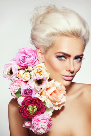 platinum hair: Portrait of young beautiful platinum blonde girl with stylish make-up, prom hairdo and flowers