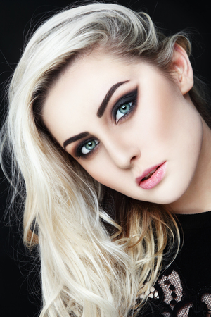 platinum hair: Portrait of young beautiful woman with long platinum blond hair and stylish winged eyes make-up