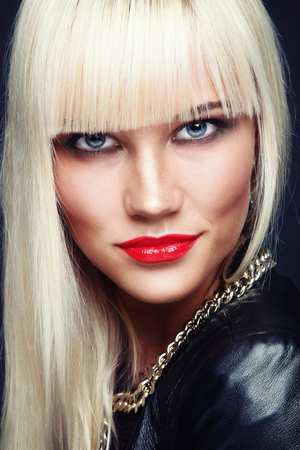 platinum hair: Portrait of young beautiful stylish platinum blond woman with red lipstick